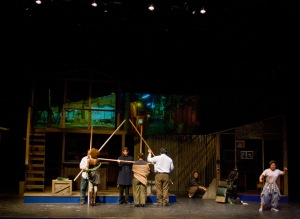 The Ensemble uses bamboo poles to create houses, landscapes and percussive sounds